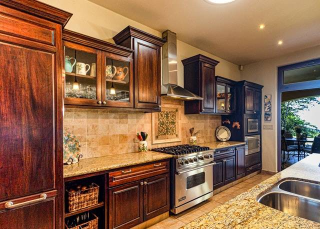 Wall and floor cabinets in kitchen.